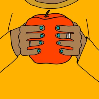 Hands with blue nail polish holding a red apple
