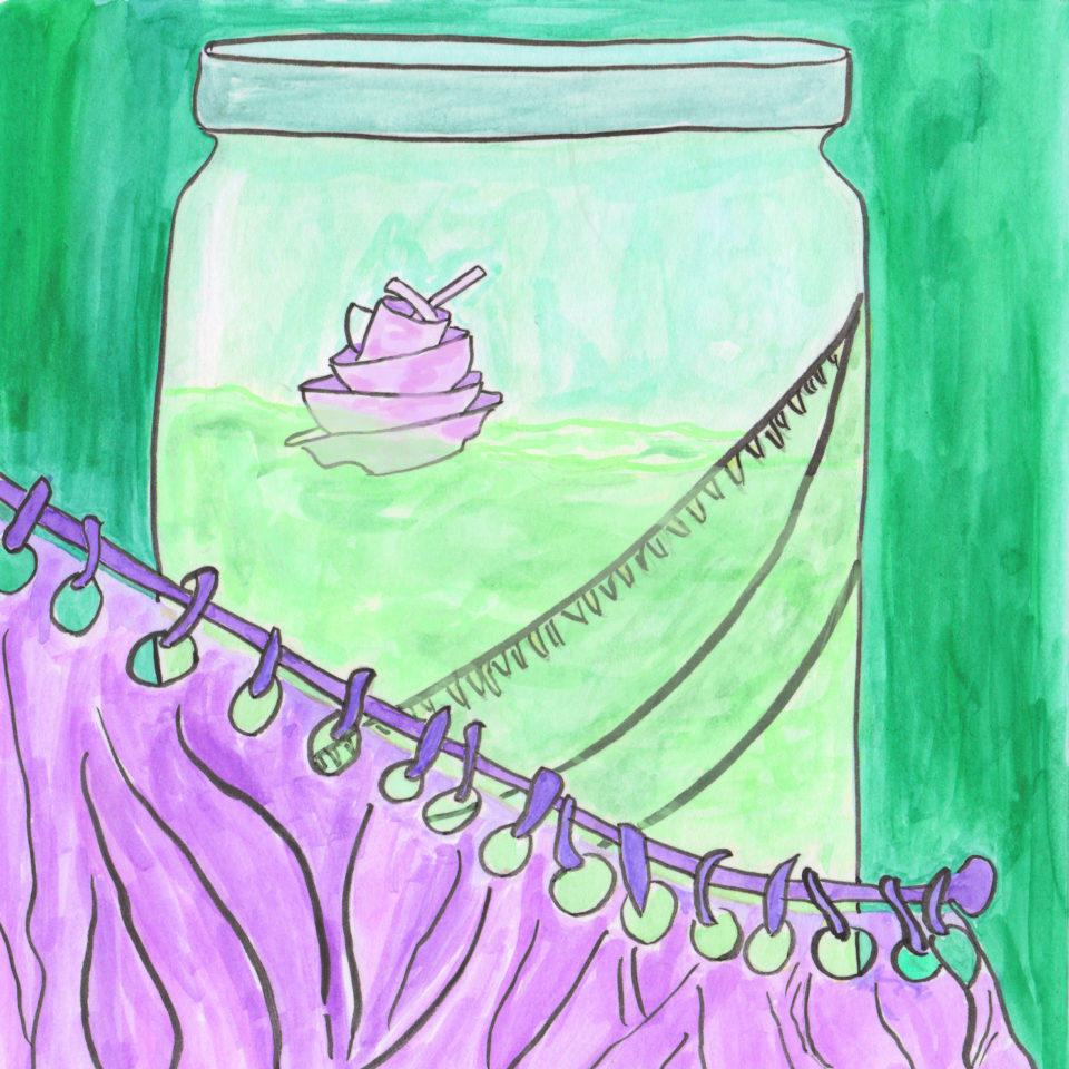 Green jar containing floating dishes behind purple curtain
