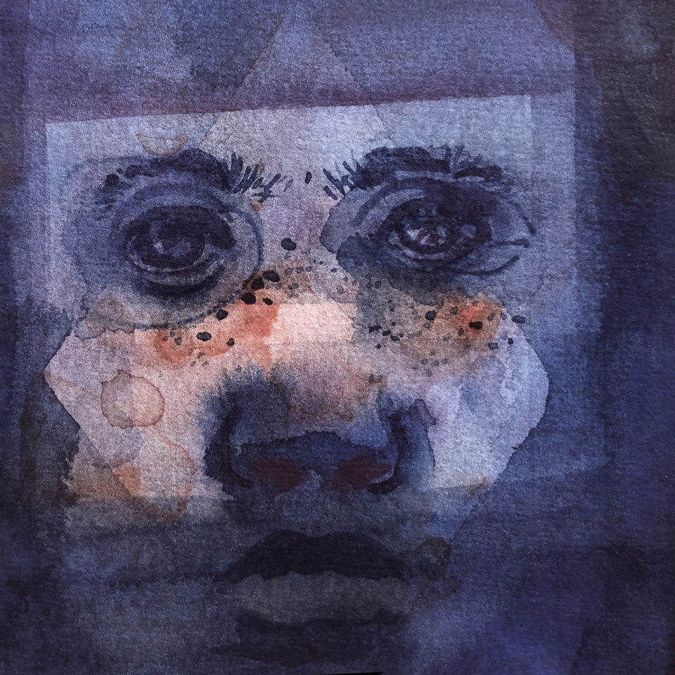 Face painted in blue watercolor with red splatter