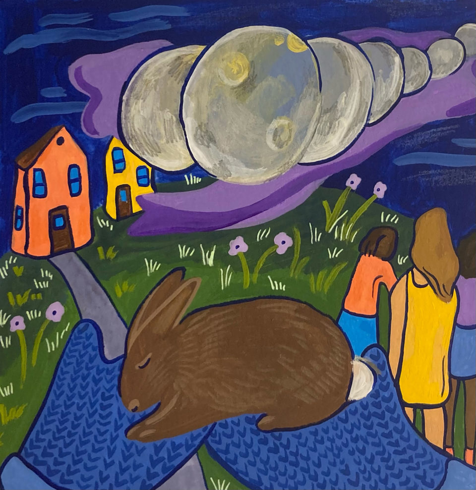 Illustration of a brown rabbit held in blue mittens. Some colorful houses, people, and the phases of the moon across the night sky in the background.